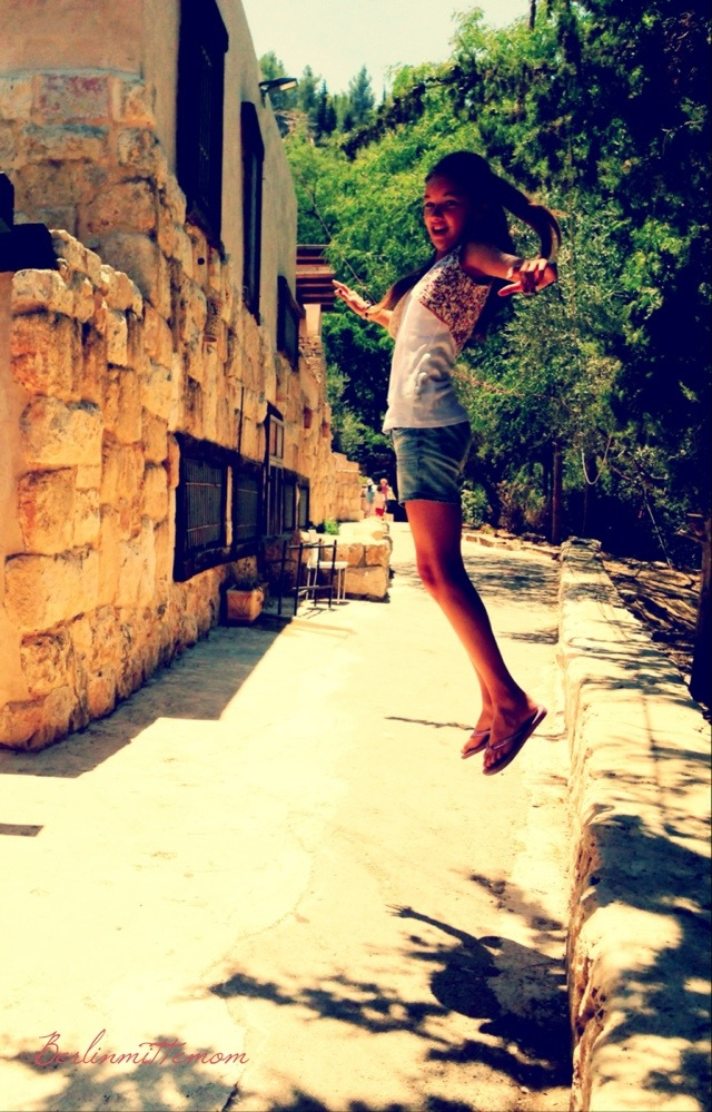 In Ein Yael, the living museum, Jerusalem. Herzensmädchen jumping, flying high