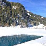 Bergpanorama und Außenpool im Robinson Club Amadé in Kleinarl, Österreich